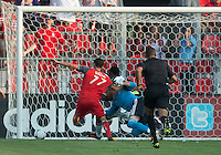 18 July 2012: Colorado Rapids goalkeeper Matt Pickens #18 grabs the shirt of Toronto FC midfielder Luis Silva #11during an MLS game between the Colorado Rapids and Toronto FC at BMO Field in Toronto..