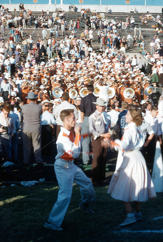 Vintage 1955 photo of University of Texas Co-Ed Cheer, Pom, and All-Girl Cheer Squads dancing to the UT Longhorn Band after winning the football game.