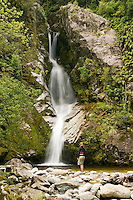 A woman at Dorothy Falls near Lake Kaniere near Hokitika - West Coast