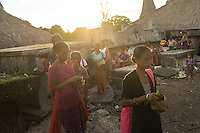 March 28, 2016 - Wainyapu (Indonesia). The evening before the big Pasola of Wainyapu, Peter's mother and sisters participate together with all the female villagers in a blessing ceremony lighting up candles and offering betel nuts to the tombs of their ancestors The tombs are normally built a few meters outside the houses as the villagers believe their ancestors will protect them. © Thomas Cristofoletti / Ruom