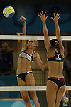 USA Beach Volleyball playerKerri Walsh spikes the ball past Elaine Youngs as she and teammate Misty May beat Holly McPeak and Elaine Youngs to advance to the Gold Medal game at the 2004 Summer Olympic Games in Athens,Greece on Sunday, August 23rd, 2004...         DENVER POST PHOTO BY STEVE DYKES