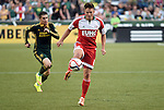 Jun 6, 2015; Portland, OR, USA; New England Revolution midfielder Kelyn Rowe (11) controls the ball as Portland Timbers defender Jorge Villafana (19) defends during the first half of the game at Providence Park. Mandatory Credit: Steve Dykes-USA TODAY Sports