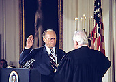 Gerald R. Ford takes the oath of office from Chief Justice Warren E. Burger as he is sworn-in as the 38th President of the United States in the East Room of the White House in Washington, DC on August 9, 1974.<br /> Credit: Arnie Sachs / CNP