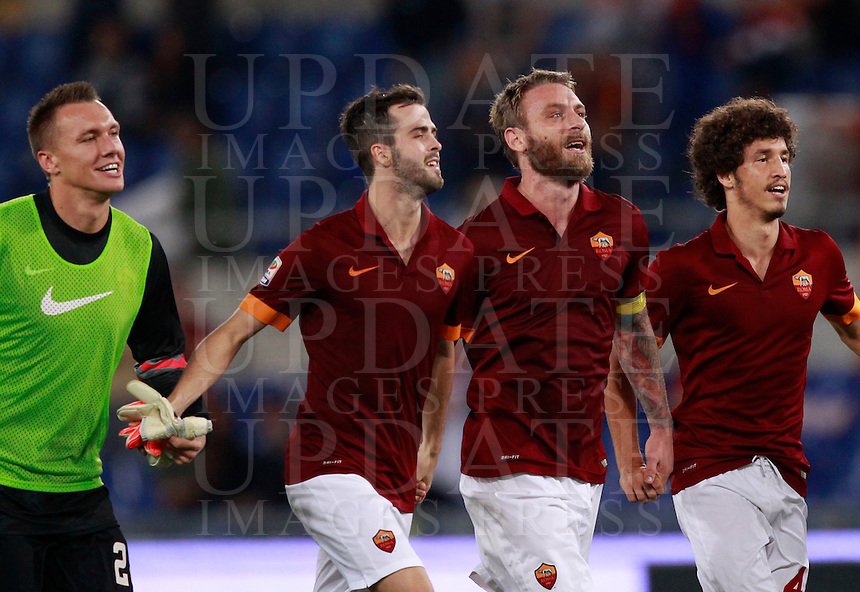 Calcio, Serie A: Roma vs ChievoVerona. Roma, stadio Olimpico, 18 ottobre 2014.<br /> From left, Roma's Lukasz Skorupski, Daniele De Rossi, Miralem Pjanic and Salih Ucan greet fans at the end of the Italian Serie A football match between Roma and ChievoVerona at Rome's Olympic stadium, 18 October 2014. Roma won 3-0.<br /> UPDATE IMAGES PRESS/Isabella Bonotto