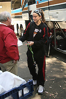 3 April 2008: The team departs for the Final Four and is sent off by fans and staff of the Athletic Department near Maples Pavilion in Stanford, CA. Pictured is JJ Hones picking up her lunch from the Jimmy V.