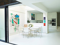 The kitchen is a bespoke design by Moxon Architects with work tops in DuPont Corian and the painting is by Sarah Stitt