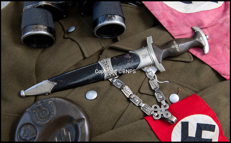 BNPS.co.uk (01202 558833)<br /> Pic: PhilYeomans/BNPS<br /> <br /> Sinister survivor from the heart of Hitler's Third Reich...<br /> <br /> The SS presentation dagger belonging to Hitler's trusted personal chauffeur - who's final mission was to collect the petrol to burn the Fuhrers body after his suicide at the Reich Chancellery has emerged for sale for £5000.<br /> <br /> SS-Obersturmbannfuhrer Erich Kempka fulfilled the key security role in the Fuhrer's entourage from 1936 until his death on April 30, 1945.<br /> <br /> The sinister 13ins dagger is engraved with Kempka's initials 'EK', along with the elite SS mark and the Nazi eagle adorning the handle.