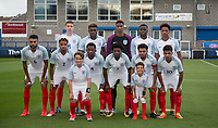 The England team pose with matchday mascots during the International friendly match between England U20 and Netherlands U20 at New Bucks Head, Telford, England on 31 August 2017. Photo by Andy Rowland.