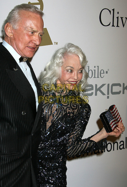 BUZZ ALDRIN & LOIS ALDRIN.51st Annual GRAMMY Awards - Salute To Icons: Clive Davis Pre-Grammy Gala held at the Beverly Hilton Hotel, Beverly Hills, California, USA..February 7th, 2009.half length black dress sequins sequined pattern clutch bag stars striped flag married husband wife .CAP/ADM/MJ.©Michael Jade/AdMedia/Capital Pictures.
