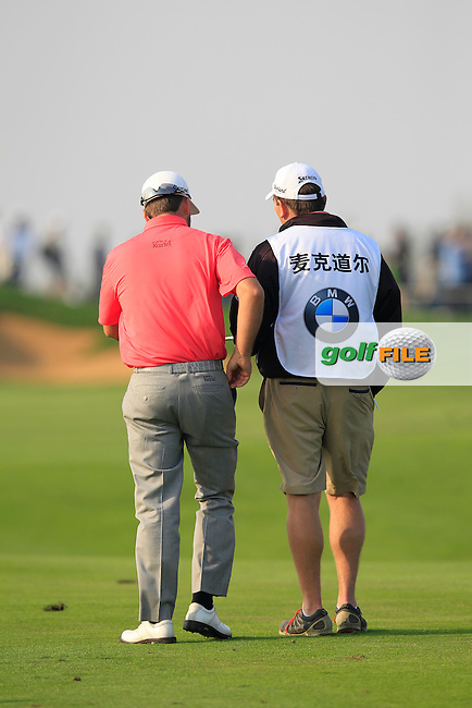 Graeme McDowell (NIR) and caddy Ken Comboy on the 16th hole during Sunday's Final Round of the 2014 BMW Masters held at Lake Malaren, Shanghai, China. 2nd November 2014.<br /> Picture: Eoin Clarke www.golffile.ie