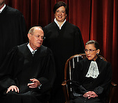 Associate Justices Anthony Kennedy and Ruth Bader Ginsberg chat as Associate Justice Elena Kagan, the newest member of the Court, look on while the Supreme Court Justices of the United States sit for a formal group photo in the East Conference Room of the Supreme Court in Washington on Friday, October 8, 2010.    .Credit: Roger L. Wollenberg - Pool via CNP