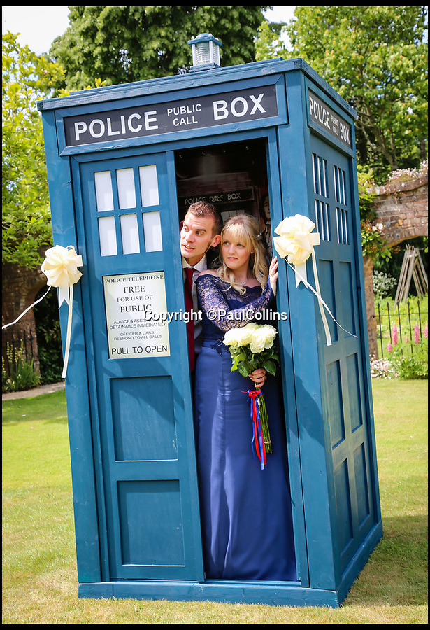BNPS.co.uk (01202)558833Pic:   PaulCollins/BNPS<br /> <br /> Bride and groom Stacey Savage and Simon Clarke  inside the Tardis.<br /> <br /> A pair of TV buffs have tied the knot in front of their friends and family - all of whom were dressed as their favourite on-screen characters.<br /> <br /> Stacey Savage, 29, and Simon Clarke, 40, married at Athelhampton House in Dorset where an episode of Doctor Who was filmed in the 1970s.<br /> <br /> To mark the special location the couple asked their guests to come dressed as their favourite fictional figures and they did not disappoint.<br /> <br /> Among the onlookers were the likes Bart and Marjoie Simpson, Mary Poppins and Bert, Mr Potato Head and Mrs Brown.<br /> <br /> The bride's parents even got into the spirit of things by arriving as the Julia Roberts and Richard Gere from Pretty Woman.