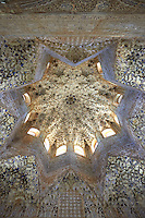 Arabesque Moorish stalactite or morcabe ceiling in the Hall of the Two Sisters, Palacios Nazaries Alhambra. Granada, Andalusia, Spain.