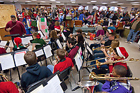 A small version of the Westerville South Marching Band performs at the head of the room while a benefit bazaar to help raise money for the band's operation goes on at the school.