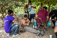 ARRIAGA, MEXICO - NOVEMBER 08: Migrants eat lunch as they beak close to the home of the smuggler, Francisco Javier Martine on the 8th of November, 2015 in Arriaga, Mexico. <br /> <br /> Daniel Berehulak for The New York Times