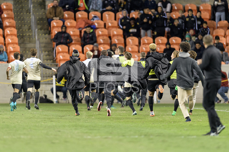Houston, TX - Friday December 9, 2016: The Wake Forest Demon Deacons team rushes the field after Ian Harkes game winning goal in overtime against the Denver Pioneers at the  NCAA Men's Soccer Semifinals at BBVA Compass Stadium.