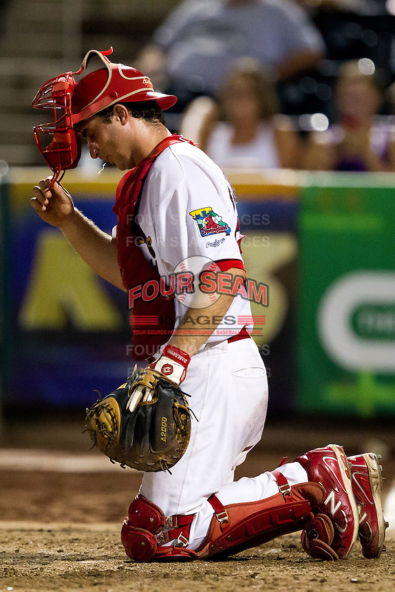 Charles Cutler (37) of the Springfield Cardinals lifts his mask to spit during a game against the Northwest Arkansas Naturals at Hammons Field on August 1, 2011 in Springfield, Missouri. Springfield defeated Northwest Arkansas 7-1. (David Welker / Four Seam Images)