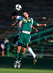 1 September 2009: Siena College Saints' backfielder Nick Viaggio (5), a Junior from Maspeth, NY, jumps high to head the ball away from University of Vermont Catamount forward D.J. Edler, a Freshman from Atlanta, GA, at Centennial Field in Burlington, Vermont. The Saints edged out the Catamounts 1-0. Mandatory Photo Credit: Ed Wolfstein Photo