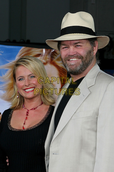 "AMI &MICKY DOLENZ.At the Los Angeles Premiere of ""Just Like Heaven"" held at Graumann's Chinese Theatre,.Los Angeles, 8th Septeber 2005.half length grey gray suit white hat black t-shirt beard mustache dress red necklace.Ref: ADM/JW .www.capitalpictures.com.sales@capitalpictures.com.© Capital Pictures."