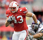 MADISON, WI - SEPTEMBER 9: Tight end Andy Crooks #43 of the Wisconsin Badgers scores a touchdown against the Western Illinois Leathernecks at Camp Randall Stadium on September 9, 2006 in Madison, Wisconsin. The Badgers beat the Leathernecks 34-10. (Photo by David Stluka)