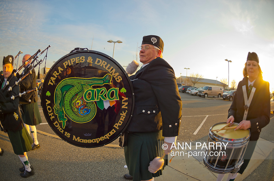 Garden City, New York, USA. December 1, 2013. Winter holiday event Festival of Trees includes musical entertainment by Tara Pipes & Drums, A.O.H. Division 15, of Massapequa Park, which played Irish bagpipe music outdoors. The event was held at Cradle of Aviation Museum, with proceeds benefiting United Cerebral Palsy Association of Nassau County, Long Island.