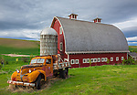 The Palouse, Whitman County, WA: Vintage flatbed truck in front of red barn and silo in summer, Palouse Country