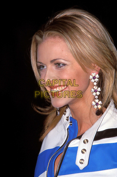 DONNA AIR.biker jacket, flower, floral earrings, smiling .Ref: 10709 .www.capitalpictures.com.sales@capitalpictures.com. © Capital Pictures