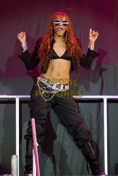 "CIARA.Opening act for 50 Cent's ""The Masacre Tour"",.at the Post-Gazette Pavilion,.Pittsburgh, 16th August 2005.full length stage gig r&b singer black combat trousers silver chain belt bra brassiere short jacket sunglasses microphone boots hands .www.capitalpictures.com.sales@capitalpictures.com.© Capital Pictures."