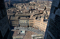 People and buildings in the Piazza del Campo seen from Torre del Mangia, Siena, Italy.