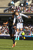Mexico City September 23, 2014. Omar Arellano (27) (top) Monterrey team receives the ball head to the defense of Eduardo Herrera (15) of Pumas, during the final day of the regular season of league MX. Encounter in which Pumas won 4-2 at Monterrey to classify quarterfinals. Photo by Miguel Angel Pantaleon/VIEWpress