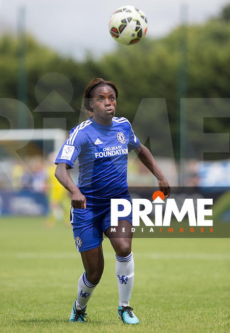 Eniola Aluko of Chelsea Ladies keeps eyes on the ball during the FAWSL match between Chelsea Ladies and Bristol Academy WFC at Wheatsheaf Park, Staines, England on 12 July 2015. Photo by Andy Rowland.