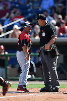 Tampa Spartans head coach Joe Urso (7) argues a call with umpire Gary Glover during an exhibition game against the Philadelphia Phillies on March 1, 2015 at Bright House Field in Clearwater, Florida.  Tampa defeated Philadelphia 6-2.  (Mike Janes/Four Seam Images)