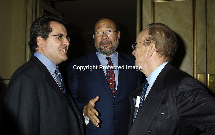 Peter Chernin, Richard Parsons and Rupert Murdoch ..at the Center for Communications Luncheon honoring Richard Parsons on October 20, 2005 at The Pierre Hotel. ..Photo by Robin Platzer, Twin Images
