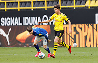 16th May 2020, Signal Iduna Park, Dortmund, Germany; Bundesliga football, Borussia Dortmund versus FC Schalke;   BVB's Leonardo Balerdi challenges for the ball with S04 Juan Miranda