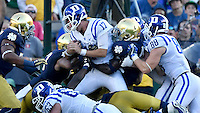 Blue Devils quarterback Daniel Jones (17) is stopped on the goal line in the fourth quarter by Notre Dame Fighting Irish linebacker Te'von Coney (4).