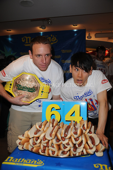 WWW.ACEPIXS.COM . . . . . ....July 2 2009, New York City....2008 Nathans Famous Hot Dog Eating Champion Joey Chestnut and previous champion Takeru Kobayashi at the official weigh-in ceremony for the 94th Annual Nathan's Famous Fourth of July International Hot Dog-Eating Contest at Macys Herald Square on July 2, 2009 in New York City.....Please byline: KRISTIN CALLAHAN - ACEPIXS.COM.. . . . . . ..Ace Pictures, Inc:  ..tel: (212) 243 8787 or (646) 769 0430..e-mail: info@acepixs.com..web: http://www.acepixs.com