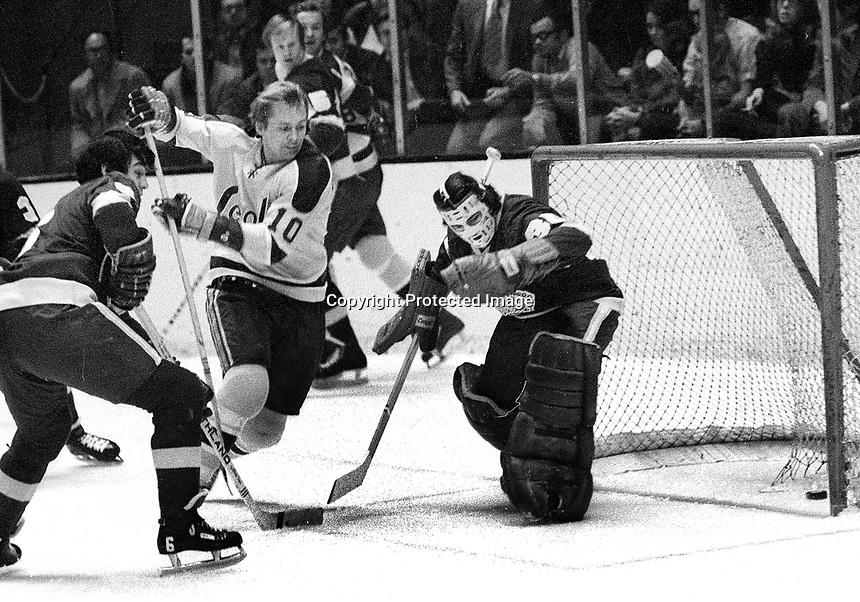Seals Stan Gilbertson scores  against Red Wing goalie Roy Edwards.<br />