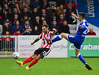 Lincoln City's Neal Eardley clears under pressure from Chesterfield's Bradley Barry<br /> <br /> Photographer Andrew Vaughan/CameraSport<br /> <br /> The EFL Sky Bet League Two - Lincoln City v Chesterfield - Saturday 7th October 2017 - Sincil Bank - Lincoln<br /> <br /> World Copyright &copy; 2017 CameraSport. All rights reserved. 43 Linden Ave. Countesthorpe. Leicester. England. LE8 5PG - Tel: +44 (0) 116 277 4147 - admin@camerasport.com - www.camerasport.com