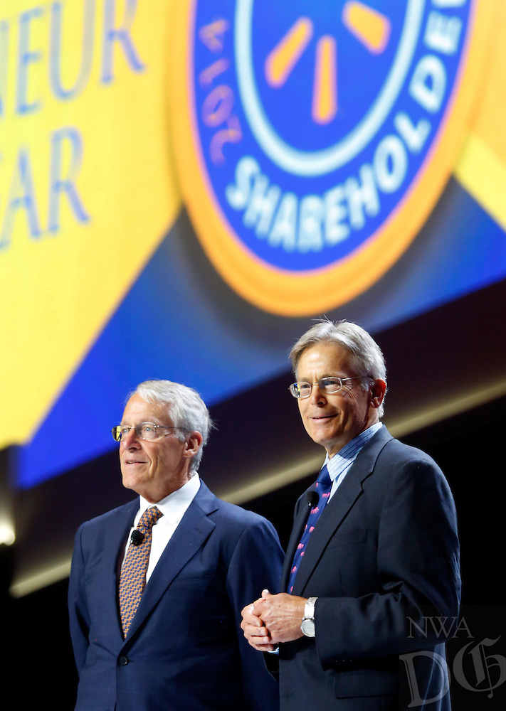 NWA Media/JASON IVESTER --06/06/2014--<br /> Brothers Rob (left) and Jim Walton speak on stage on Friday, June 6, 2014, during the annual Shareholders Meeting inside Bud Walton Arena in Fayetteville.