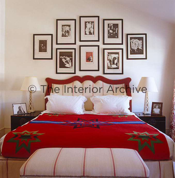 The master bedroom is themed red and white with a bright red blanket covering the bed
