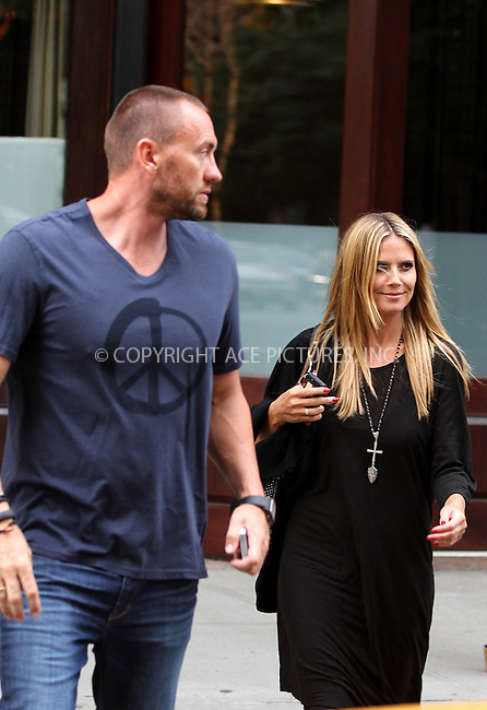 WWW.ACEPIXS.COM<br /> <br /> July 8 2013, New York City<br /> <br /> Heidi Klum and Martin Kristen leave a downtown hotel on July 8 2013 in New York City<br /> <br /> By Line: Zelig Shaul/ACE Pictures<br /> <br /> <br /> ACE Pictures, Inc.<br /> tel: 646 769 0430<br /> Email: info@acepixs.com<br /> www.acepixs.com