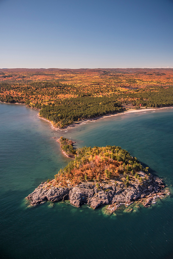 Aerial photography of LIttle Presque Isle and the rugged Lake Superior shoreline near Marquette, Michigan during fall color season.