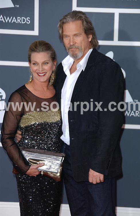 **ALL ROUND PICTURES FROM SOLARPIX.COM**.**SYNDICATION RIGHTS FOR UK, AUSTRALIA, DENMARK, PORTUGAL, S. AFRICA, SPAIN & DUBAI (U.A.E) ONLY**.arrivals for the 52nd Annual GRAMMY Awards at the Staples Center at the Los Angeles, CA, USA. 31 January 2010..This pic: Jeff Bridges and Susan Geston..JOB REF: 10591 PHZ Ortega   DATE: 31_01_2010.**MUST CREDIT SOLARPIX.COM OR DOUBLE FEE WILL BE CHARGED**.**MUST NOTIFY SOLARPIX OF ONLINE USAGE**.**CALL US ON: +34 952 811 768 or LOW RATE FROM UK 0844 617 7637**