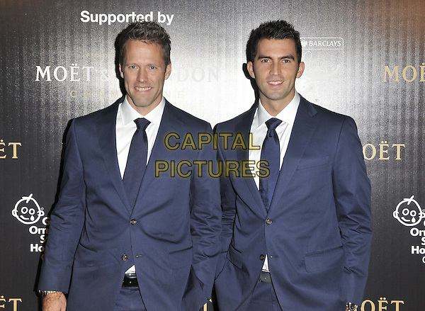 Robert Lindstedt & Horia Tecau.attended the Barclays ATP World Tour Finals official launch party, Battersea Power Station, Cringle St., London, England, UK, 17th November 2011..half length black suit blue tie white shirt .CAP/CAN.©Can Nguyen/Capital Pictures.