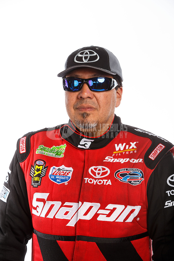 Feb 10, 2016; Pomona, CA, USA; NHRA funny car driver Cruz Pedregon poses for a portrait during media day at Auto Club Raceway at Pomona. Mandatory Credit: Mark J. Rebilas-USA TODAY Sports