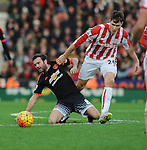 Juan Mata of Manchester United is challenged by Philipp Wollscheid of Stoke City<br /> - Barclays Premier League - Stoke City vs Manchester United - Britannia Stadium - Stoke on Trent - England - 26th December 2015 - Pic Robin Parker/Sportimage
