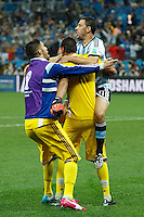 Maxi Rodriguez of Argentina celebrate scoring the winning penalty with Goalkeeper Sergio Romero