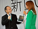 March 16, 2012, Tokyo, Japan - President Masayoshi Son, left, of Japans Softbank, and Triendl Reina, its TV commercial character, jointly set the mood for the release of the New iPad, Apples third-generation tablet computer, at its flagship store in Tokyos Ginza shopping district on Friday, March 16, 2012...Apple manias lined up well before the opening of the store to grab the new Apple product. Japan was one of the initial 10 countries where the brand new iPad hit shelves as earely as 8:00 in the morning. (Photo by Natsuki Sakai/AFLO) AYF -mis-.