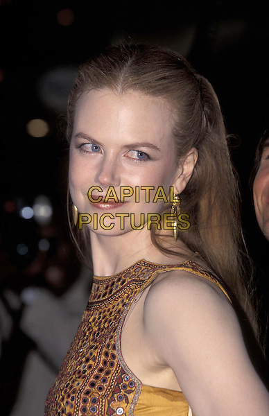 NICOLE KIDMAN.portrait headshot gold earings orange top.13 September 1999.ref:8800.www.capitalpictures.com.sales@capitalpictures.com.©Capital Pictures