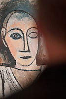 A guest studies 'Buste d'homme' by Picasso during SAM Remix on Saturday, Nov. 13, 2010.